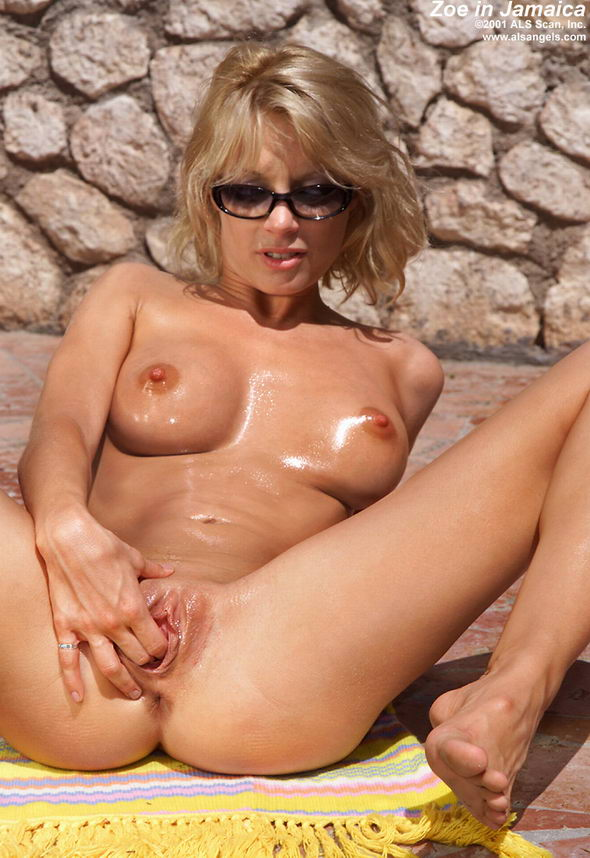 image Ashlie shows opened wet pussy closeup
